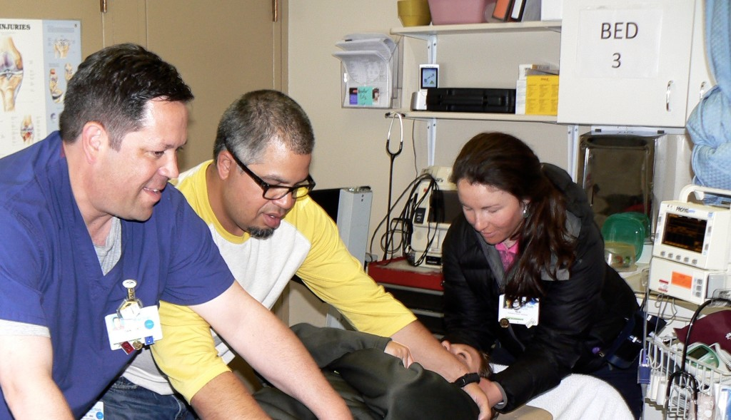 Clinic staff assessing a patient